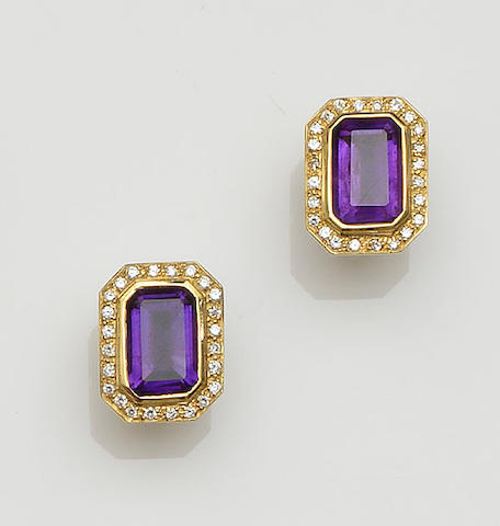 A pair of diamond and amethyst earclips