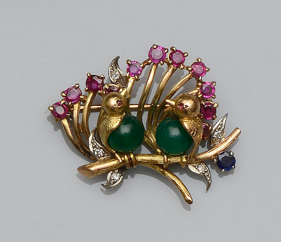 A vari gem-set bird brooch