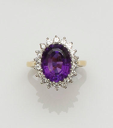 An 18ct gold amethyst and diamond cluster ring