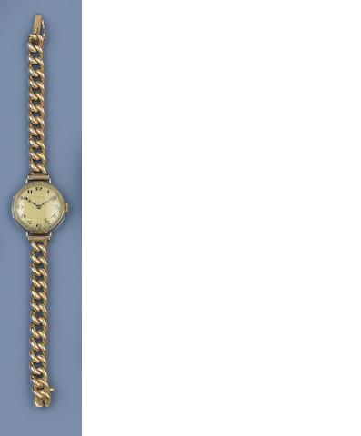 A pair of 18ct gold cufflinks, and a wristwatch, by Longines  (2)