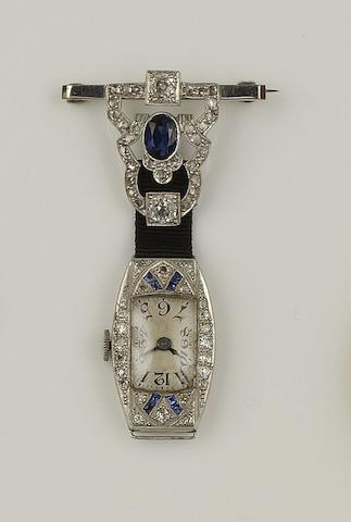 A sapphire and diamond cocktail watch suspended from a sapphire and diamond brooch