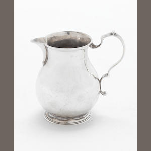 A late 18th century American colonial silver cream jug, possibly by Robert Douglas Conneticut