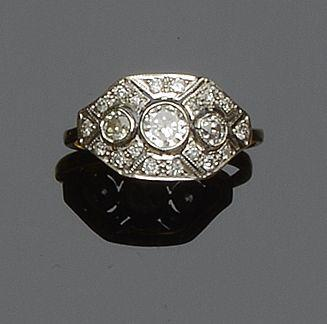 A modern diamond panel ring