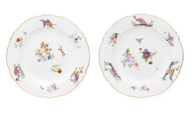 A pair of Meissen plate from a tableservice made for Frederick the Great, decorated with birds, fruit and flowers on an Ozier border