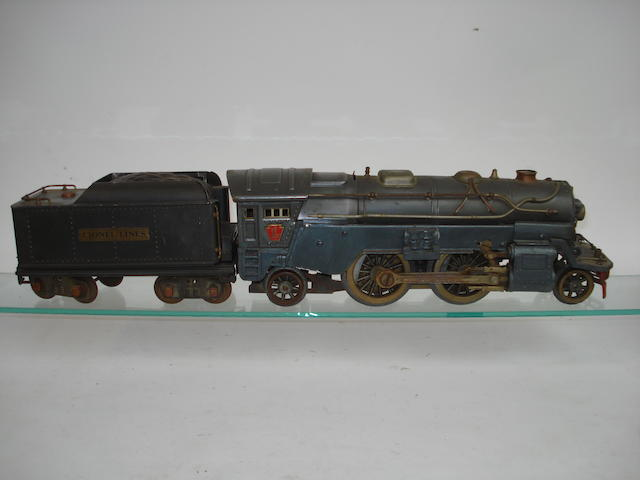 A Lionel standard gauge (2 1/8in gauge) 385E 2-4-2 locomotive and tender, circa 1933