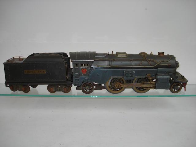 A Lionel standard gauge (2 1/8in gauge) 385E 2-4-2 locomotive and tender, circa 1933