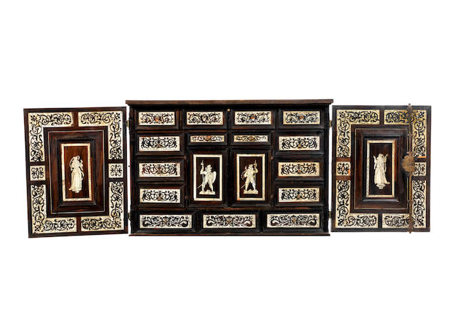 A German 17th century etched ivory and bone inlaid ebony and ebonised cabinet