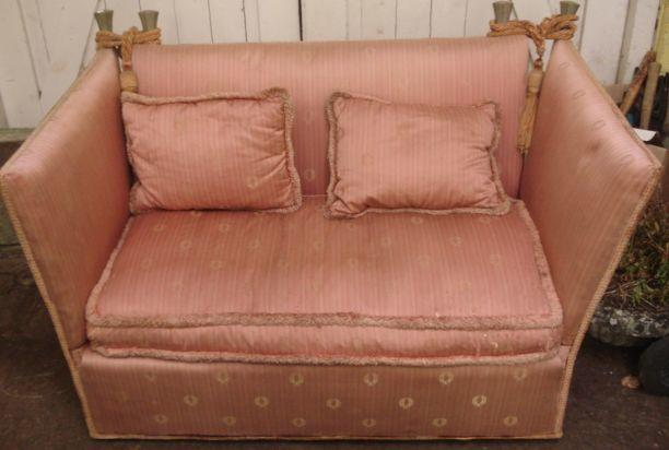 A Knoll two seat settee, first half 20th Century, of small proportions, with loose cushions, 122cm.