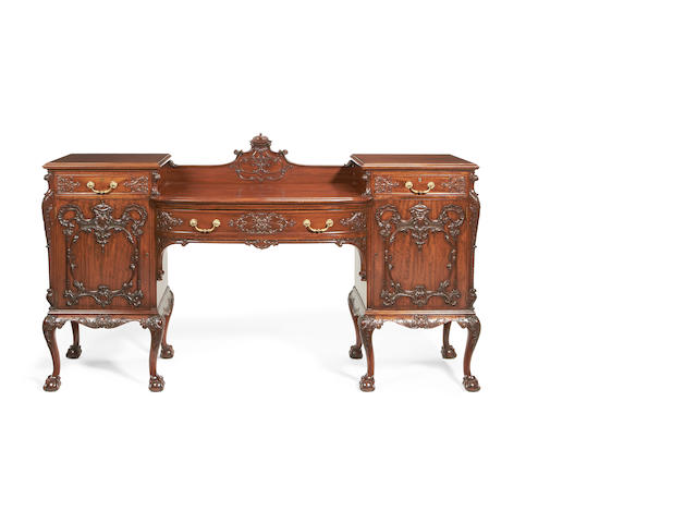 An early 20th century mahogany matched dining room suite with Chippendale Revival style