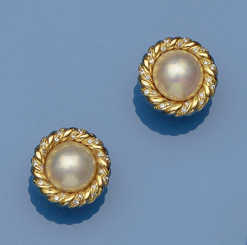 A pair of 18ct gold  mabé pearl and diamond earclips