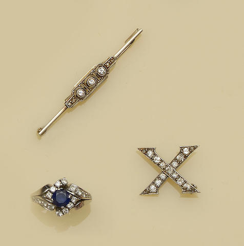 A sapphire and diamond dress ring and two diamond set brooches  (3)