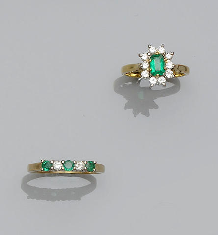 An emerald and diamond cluster ring and a five stone emerald and diamond ring (2)