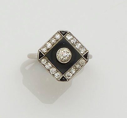 An Art Deco onyx and diamond panel ring