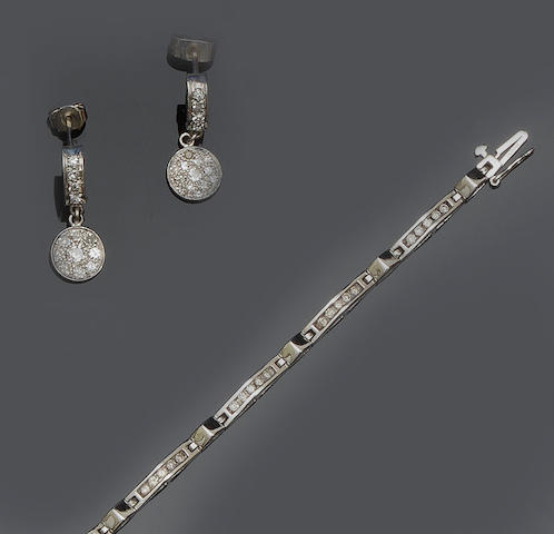 A diamond bracelet and a pair of diamond earrings (2)