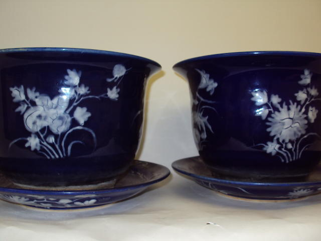 A pair of Chinese 20th century dark blue planters and stands
