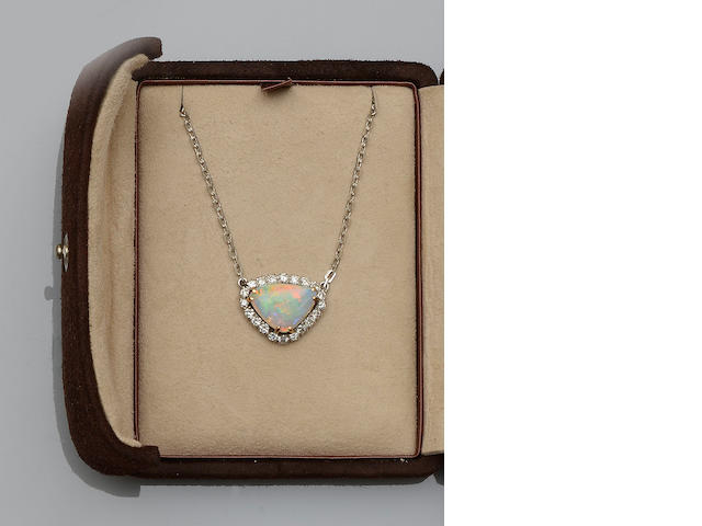 An opal and diamond pendant and ring, an amethyst pendant and a diamond ring (4)
