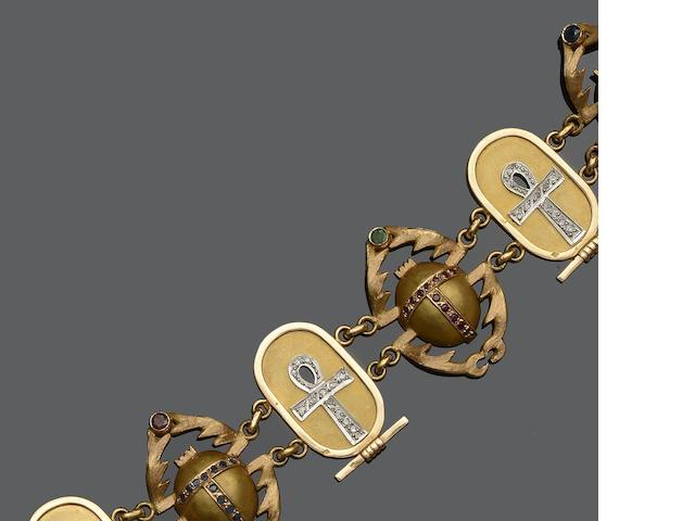 A gem set Egyptian motif bracelet