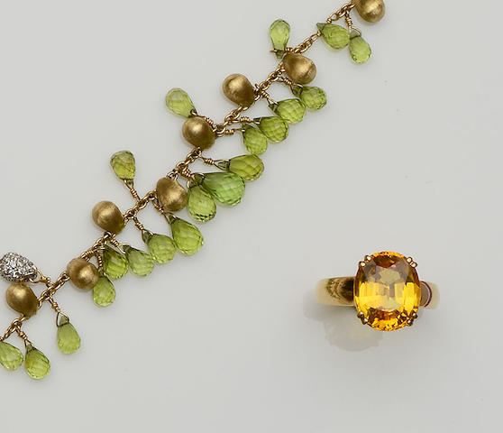 An 18ct gold peridot bracelet and a yellow sapphire ring (2)