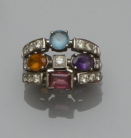 A diamond and vari gem-set ring