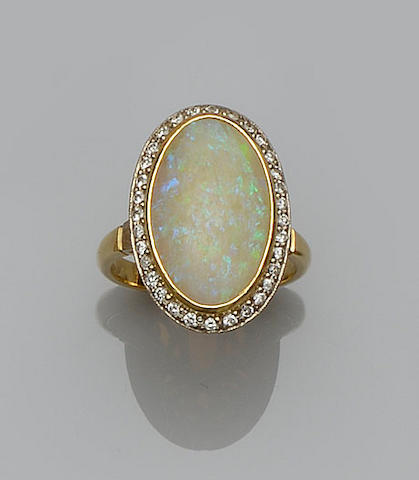 A large opal and diamond cluster ring