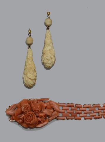 A carved coral bracelet, and a pair of carved ivory earpendants  (2)