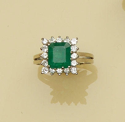 An emerald and diamond square cluster ring