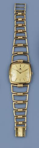 Jaeger Le Coultre: A yellow precious metal wristwatch