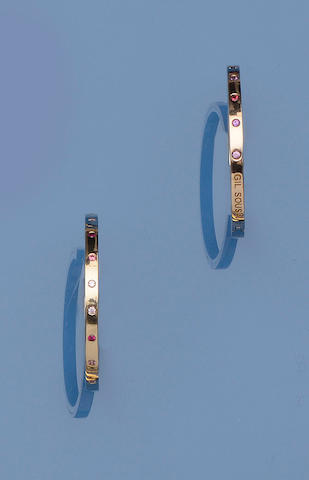 A pair of vari gem-set earhoops, by Gil Sousa