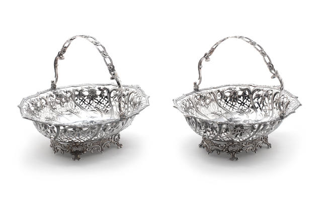 A pair of Victorian silver swing-handle baskets by George Angell, London 1859