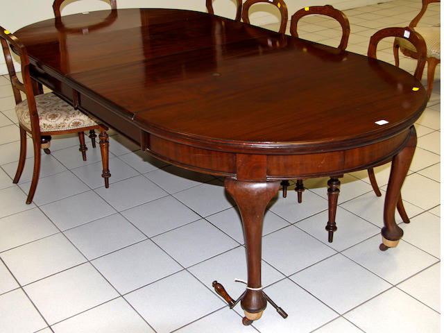 A 1920's mahogany dining table,