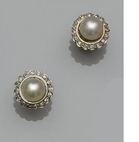 A pair of cultured pearl and diamond earstuds