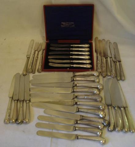 Seven pistol grip handled dinner knives, with later stainless blades, ten similar supper knives, damage and repairs, a cased set of silver filled handled tea knives, Sheffield 1906, nine filled handled tea knives and three forks one with silver blade.