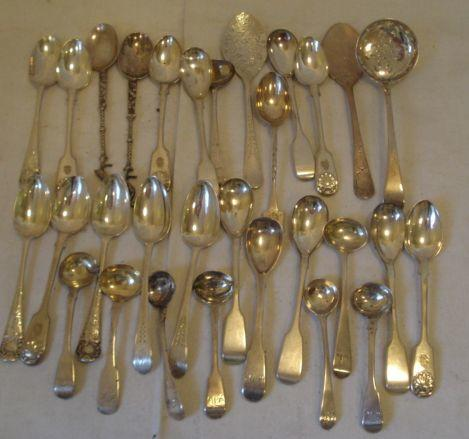 Eight various silver fiddle pattern salt spoons, other silver and plated tea and condiment spoons, silver egg spoons and five other plated egg spoons, a sifter spoon 1780 two Dutch silver spoons with stork finials two engraved jam spoons and a Commemorative spoon.