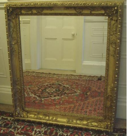 A 19th Century gilt gesso framed mirror, the bevelled rectangular plate within a leaf and scroll moulded frame with egg and scroll border, 100 x 88cm.