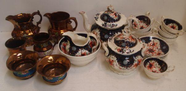 A Victorian Gaudy Welsh tea service, 36 pieces, typically floral decorated, three Victorian copper lustre jugs, a mug and two sugar bowls. (32)