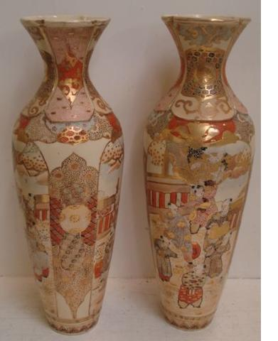 A pair of Japanese Satsuma inverted baluster vases, Meiji, painted with figure panels, within a brocaded and diaper panelled ground, heightened with gilding, 52cm.