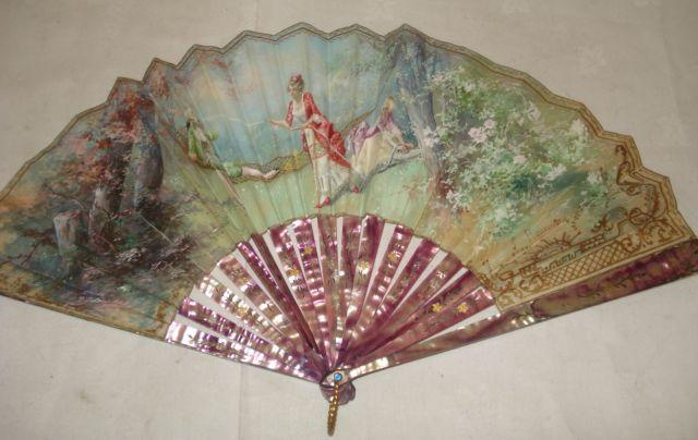 A 19th Century fan, the printed and painted leaf with figures in a garden signed 'P GARCIA', with inlaid and pink stained mother of pearl sticks and another larger painted with birds on a fence, polished bone sticks and guards.