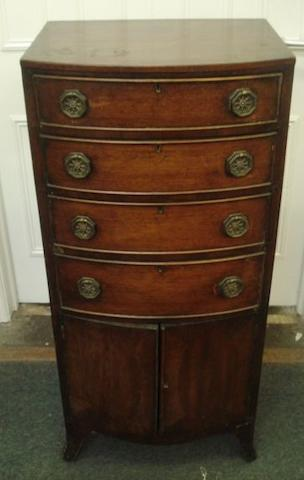 A reproduction mahogany tallboy, bowfronted with four graduated drawers over cupboard doors on a shaped apron and bracket, 51cm wide x 112cm high.