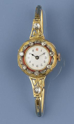 An enamel and diamond set lady's wristwatch