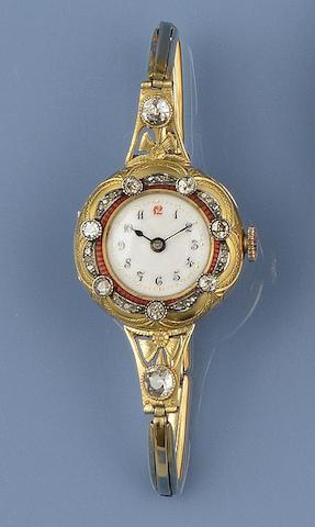 An enamel and diamond set lady's wristwatch