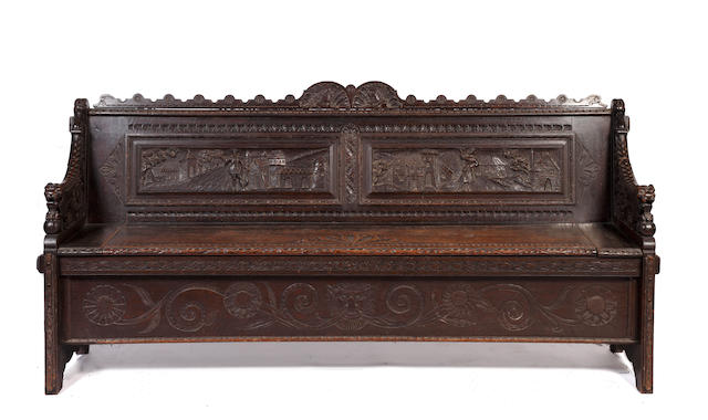 A 19th century  Flemish carved oak hall box settle,