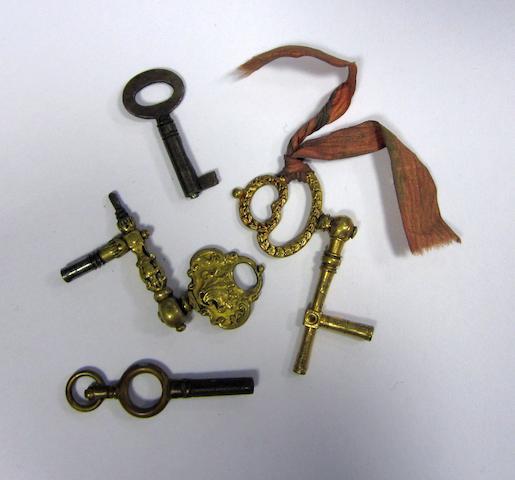 A lot of four pocket watch keys including two gilt metal crank keys