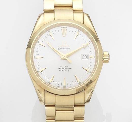 Omega. An 18ct gold automatic calendar bracelet watch with papers Seamaster Co-Axial, Ref:21033000, Case No.806******, Movement No.806*****, Sold 31st December 2005