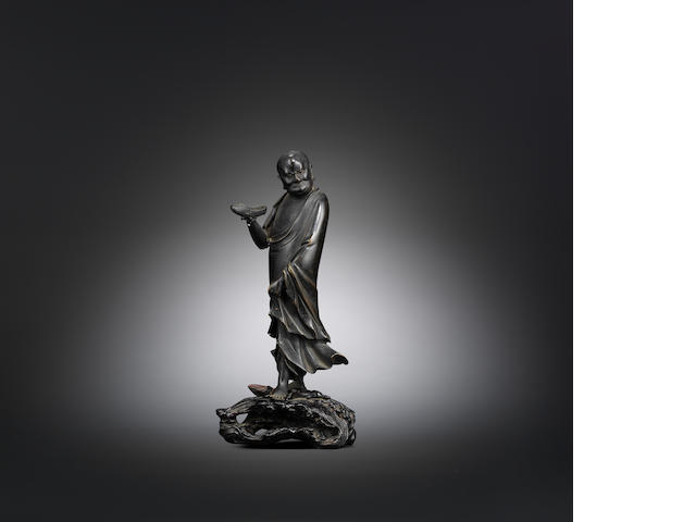 A bronze figure of Bodhidharma with zitan stand Wanli/Jiajing