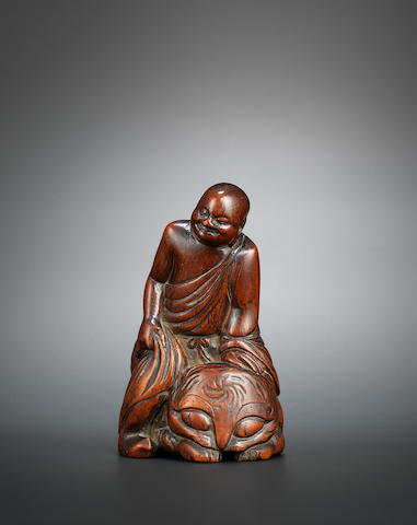 A bamboo figure of Pindola taming the tiger Mid Ming dynasty, 16th century