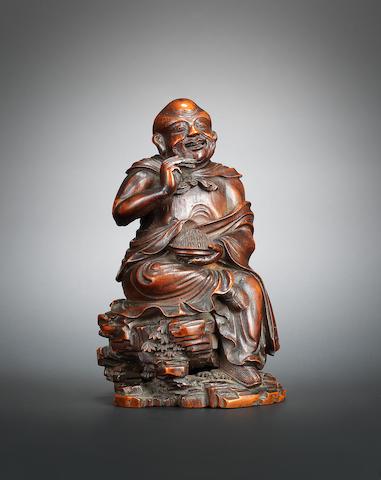A bamboo figure of a luohan holding pine needle Qianlong, signed Wang Yun