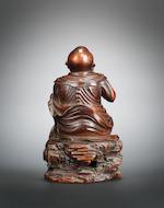 A rare bamboo figure of a luohan Qianlong, signed Wang Yun