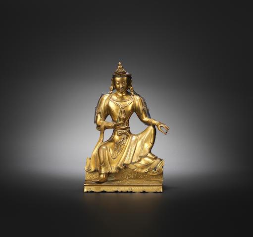 A gilt-bronze seated figure of Guanyin Qianlong