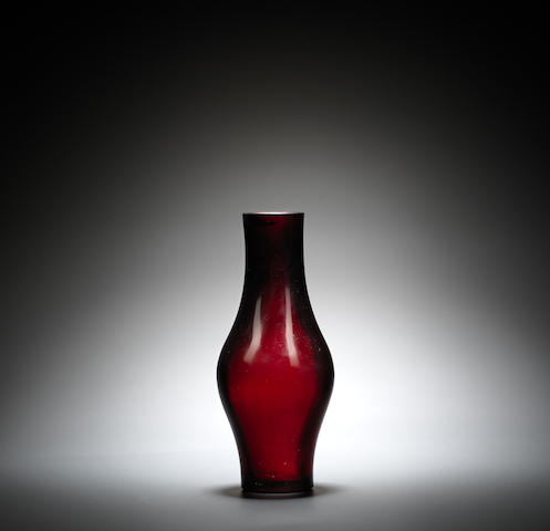 A ruby red glass 'spindle' vase Qianlong wheel-cut four-character mark and of the period