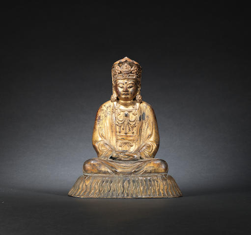 A gilt-bronze seated figure of a Guanyin Ming dynasty
